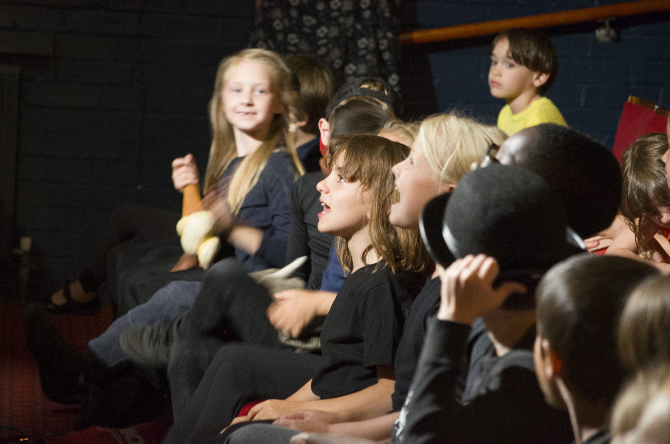 Children watching a performance
