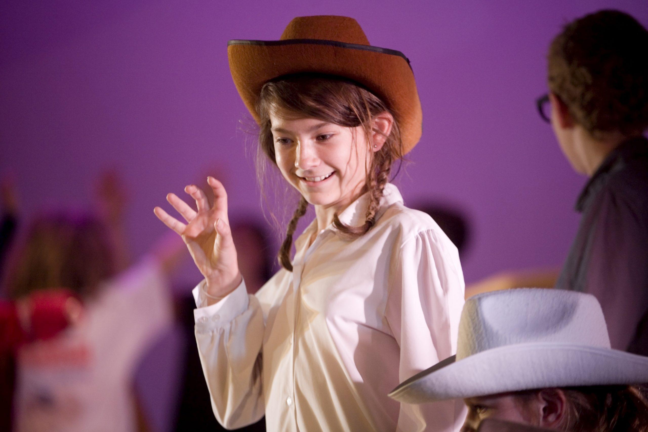 Girl wearing cowboy hat at Polka playhouse