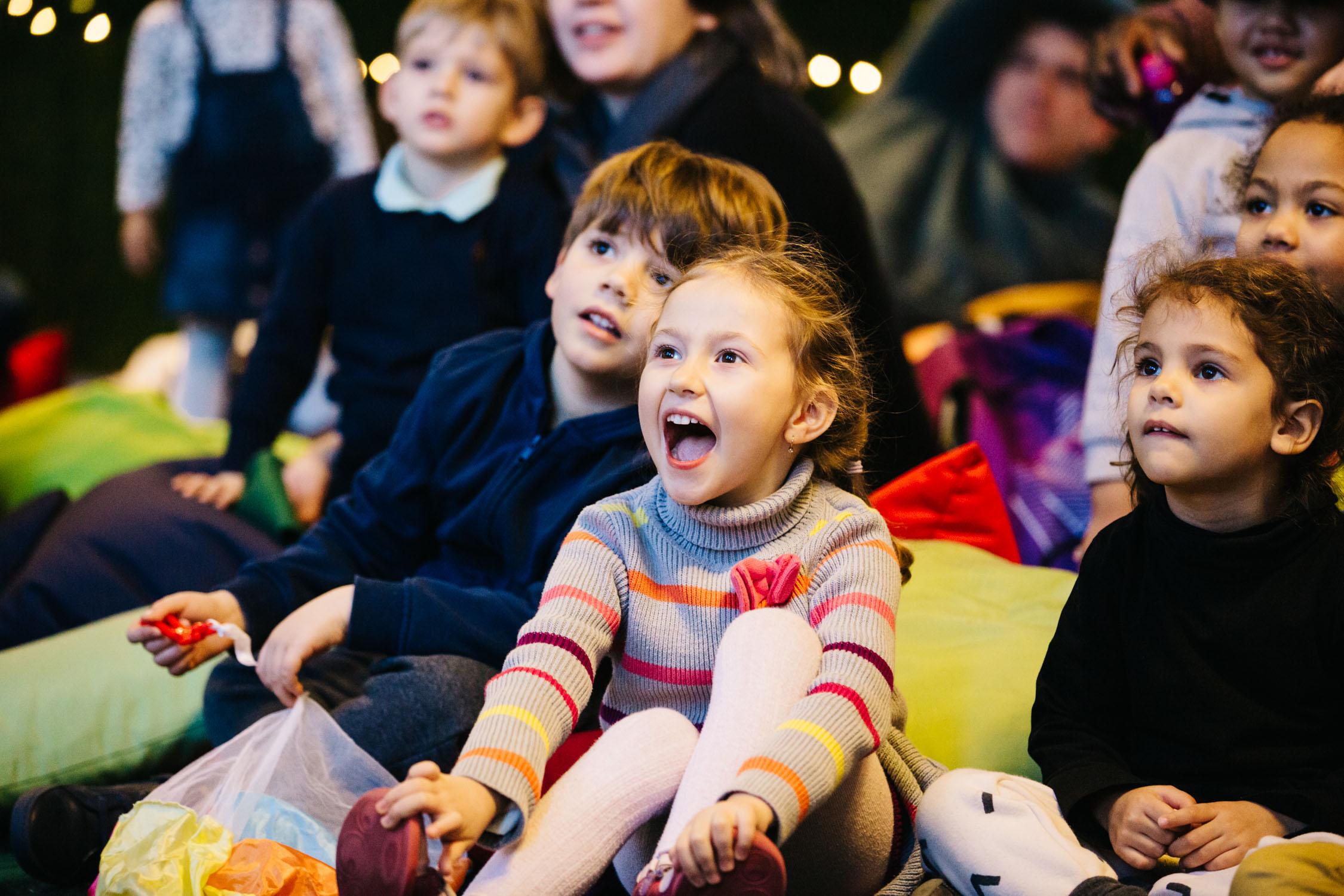 Little girl smiling watching Polka performance