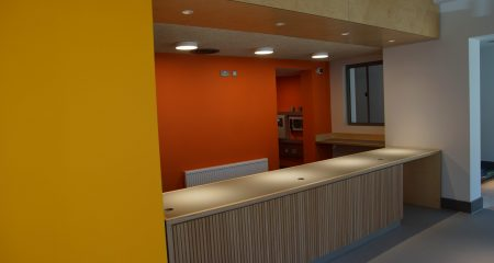 Polka's newly refurbished box office with yellow and orange walls