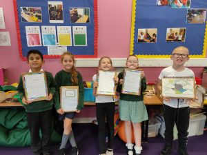 Students from Kings Oak showing off their work